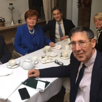 Sally Painter (back right) on Atlantic Council delegation visit to Riga, Latvia with former President of Latvia Vaira Vike-Freiberga (center facing) and Damon Wilson, the Honorable Ellen Tauscher, and Ambassador John Herbst (clockwise)